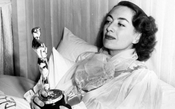 """Joan Crawford with her Oscar for """"Mildred Pierce"""""""