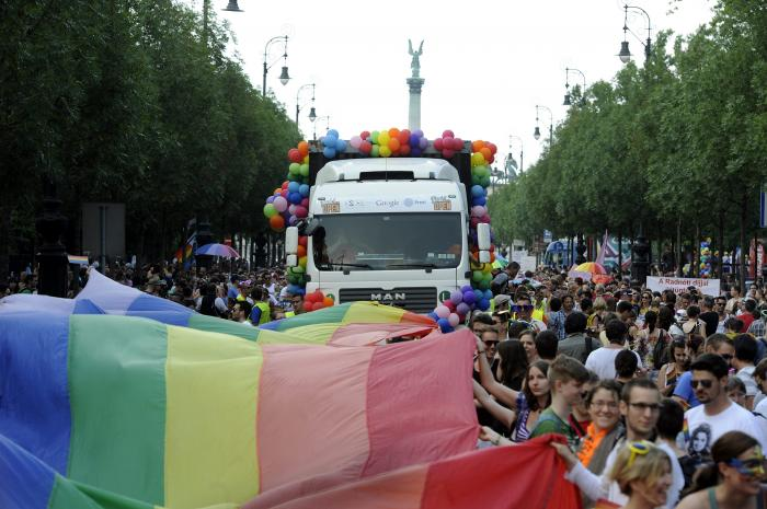 Participants walk down Andrassy Street under a giant rainbow flag during the 18th Budapest Gay Pride March in Budapest, Hungary.