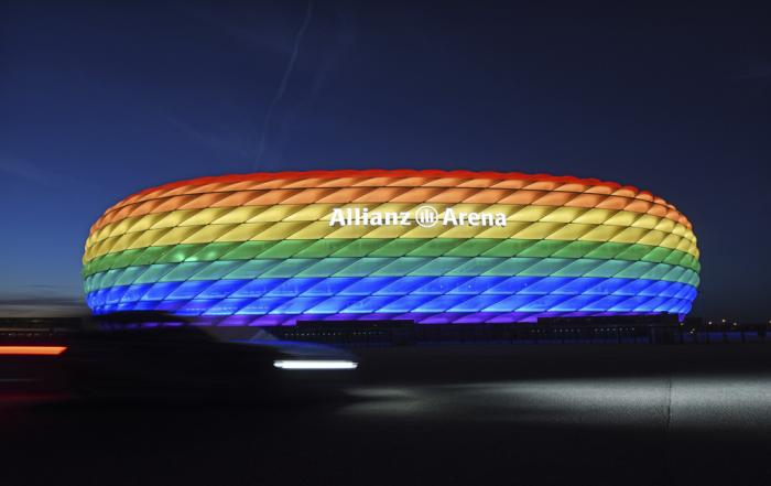 Munich's stadium is illuminated in rainbow colors on the occasion of Christopher Street Day in Munich, Germany, Saturday, July 9, 2016