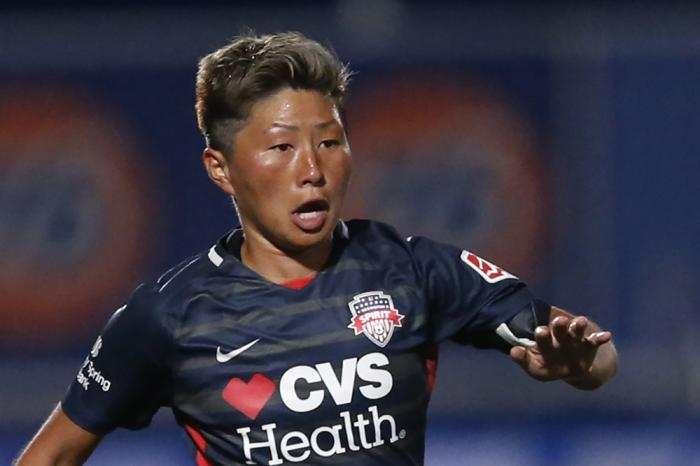 In this June 27, 2020, file photo, Washington Spirit forward Kumi Yokoyama dribbles the ball during the second half of an NWSL Challenge Cup soccer match against Chicago Red Stars at Zions Bank Stadium, in Herriman, Utah
