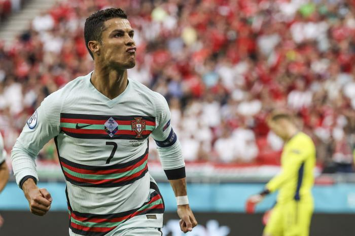 Portugal's Cristiano Ronaldo celebrates after scoring his second team goal during the Euro 2020 soccer championship group F match between Hungary and Portugal at the Ferenc Puskas stadium in Budapest, Hungary.