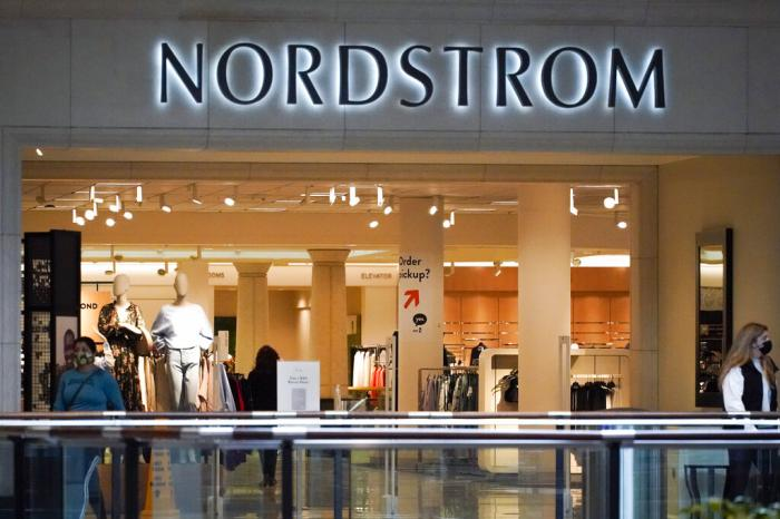Shoppers walk near an entrance to a Nordstrom store at a shopping mall in Pittsburgh.