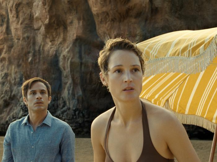 This image released by Universal Pictures shows Gael García Bernal and Vicky Krieps in a scene from 'Old'