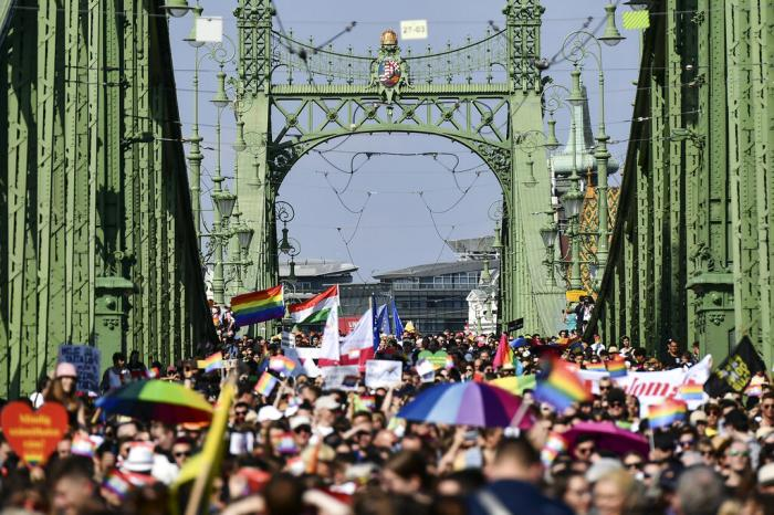 People march across the Szabadsag, or Freedom Bridge, over the River Danube in downtown Budapest during a gay pride parade in Budapest, Hungary, Saturday, July 24, 2021.