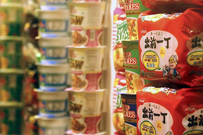Packets of instant noodles sit on display in the Cup Noodles Museum in Yokohama, Japan.