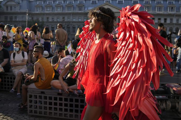 A participant wears a red outfit during the gay pride march in Bucharest, Romania, Saturday, Aug. 14, 2021.