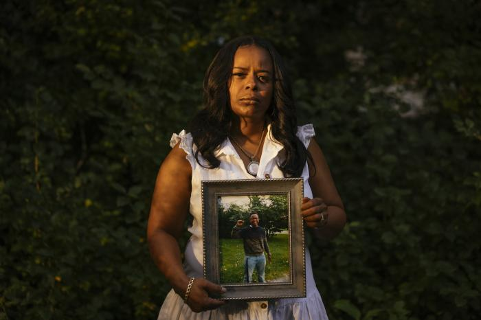 Rafiah Maxie holds a photo of her son, Jamal Clay, who died by suicide in May 2020. Research shows that while suicide rates have dropped for white Americans in recent years, it is a growing crisis for communities of color.