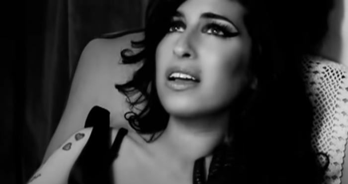 """Amy Winehouse in her """"Back to Black"""" music video."""""""