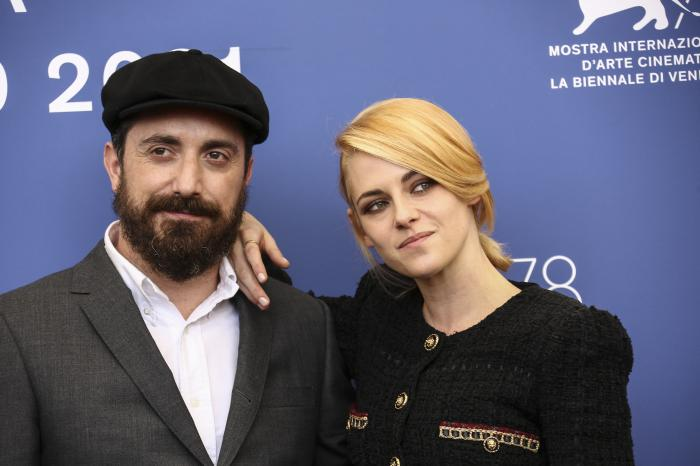 Pablo Larrain, left, and Kristen Stewart pose for photographers at the photo call for the film 'Spencer' during the 78th edition of the Venice Film Festival.