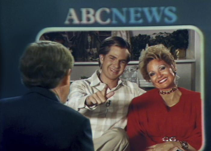 """Andrew Garfield as Jim Bakker, center, and Jessica Chastain as Tammy Faye Bakker in a scene from """"The Eyes of Tammy Faye."""""""