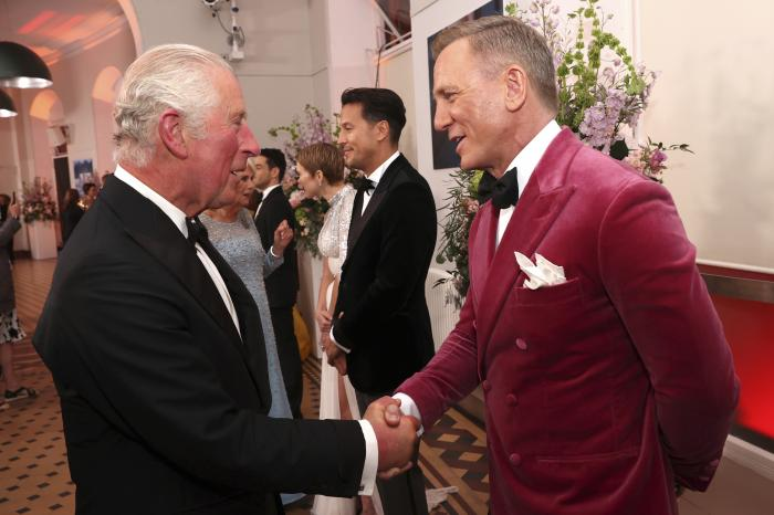 """Britain's Prince Charles, left, meets some of the cast including actor Daniel Craig, right, at the world premiere of the new James Bond film """"No Time To Die"""" at Royal Albert Hall in London."""