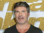 Simon Cowell Injures Back While Testing Electric Bicycle